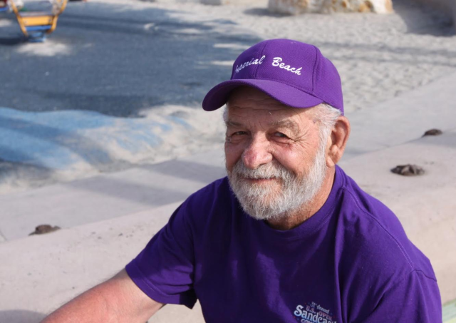 Bud Harbin at the 30th Annual U.S. Open Sandcastle Competition. Harbin was a co-founder of the competition and chair of its organizing committee for more than two decades. Photo credit: Khari Johnson